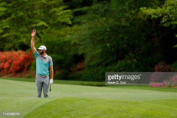 Dustin Johnson of the United States celebrates after chipping in for birdie on the 13th hole during the second round of the Masters at Augusta...