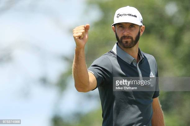 Dustin Johnson of the United States celebrates after making a birdie on the seventh hole during the second round of the 2018 US Open at Shinnecock...