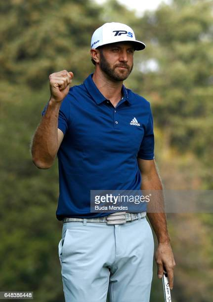 Dustin Johnson of the United States celebrates after putting on the 18th hole to win the World Golf Championships Mexico Championship at Club De Golf...