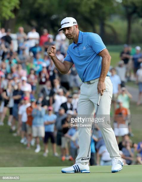Dustin Johnson of the United States celebrates holing the winning putt on the 18th green to win by 1 up in his match against John Rahm of Spain...