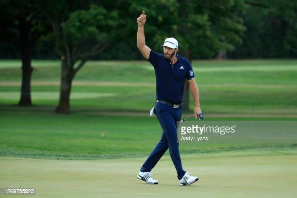 Dustin Johnson of the United States celebrates making his putt for birdie on the 18th hole during the final round of the BMW Championship on the...