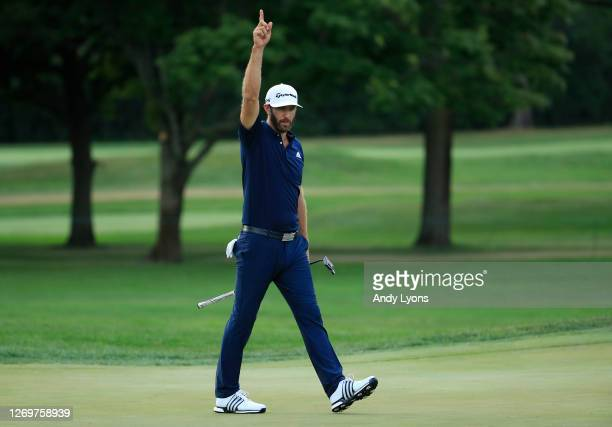 Dustin Johnson of the United States celebrates making his putt for birdie on the 18th hole to force a playoff during the final round of the BMW...