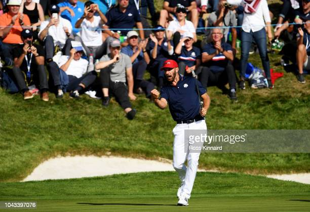 Dustin Johnson of the United States celebrates on the 11th during singles matches of the 2018 Ryder Cup at Le Golf National on September 30 2018 in...