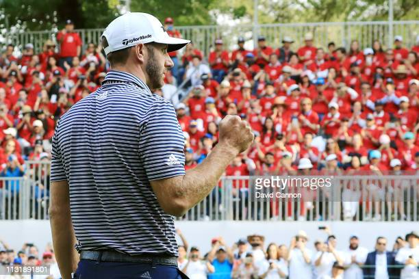 Dustin Johnson of the United States celebrates on the 18th green after making a par to win the World Golf Championships-Mexico Championship at Club...