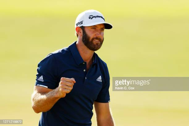 Dustin Johnson of the United States celebrates on the 18th green after winning the FedEx Cup in the final round of the TOUR Championship at East Lake...