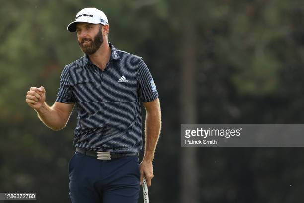 Dustin Johnson of the United States celebrates on the 18th green after winning the Masters at Augusta National Golf Club on November 15, 2020 in...