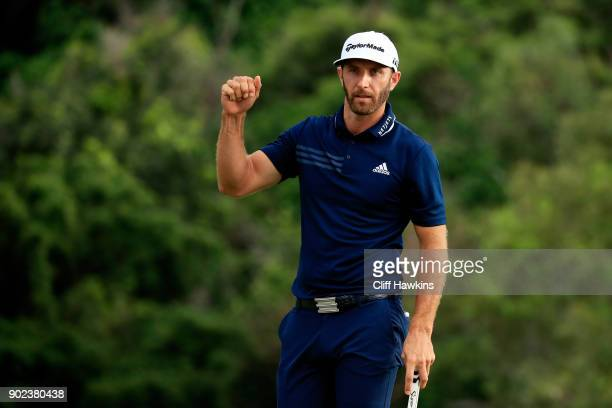 Dustin Johnson of the United States celebrates on the 18th green after winning during the final round of the Sentry Tournament of Champions at...