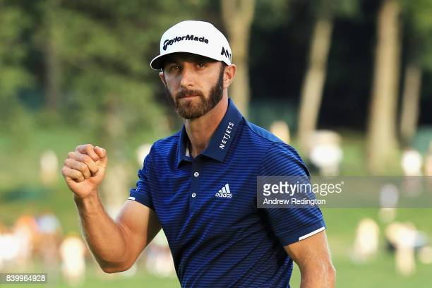 Dustin Johnson of the United States celebrates putting for birdie on the 18th green to defeat Jordan Spieth of the United States in a playoff to win...