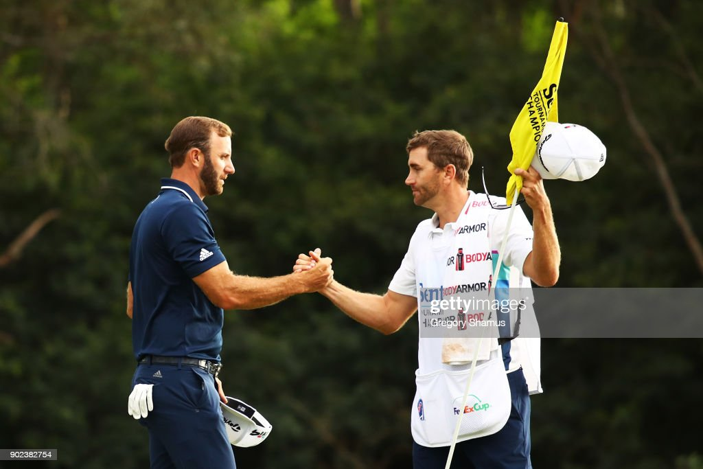 Dustin Johnson of the United States celebrates with his caddie and brother Austin on the 18th green after winning during the final round of the Sentry Tournament of Champions at Plantation Course at Kapalua Golf Club on January 7, 2018 in Lahaina, Hawaii.