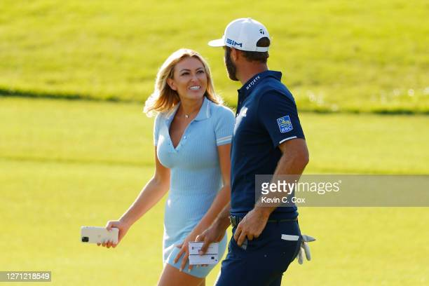 Dustin Johnson of the United States celebrates with his partner Paulina Gretzky on the 18th green after winning the FedEx Cup in the final round of...