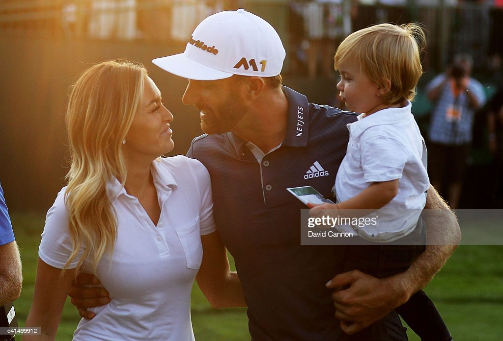 Dustin Johnson of the United States celebrates with partner Paulina Gretzky and son Tatum after winning the U.S. Open at Oakmont Country Club on June 19, 2016 in Oakmont, Pennsylvania.