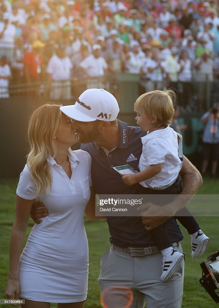 Dustin Johnson of the United States celebrates with partner Paulina Gretzky and son Tatum after winning the final round of the U.S. Open at Oakmont Country Club on June 19, 2016 in Oakmont, Pennsylvania.