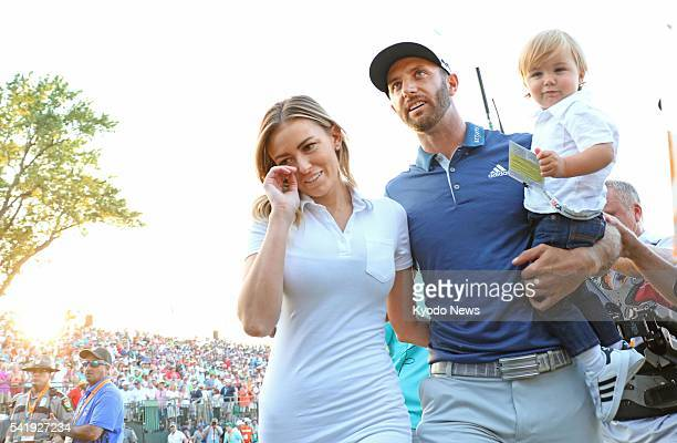 Dustin Johnson of the United States celebrates with partner Paulina Gretzky and their son Tatum after winning the US Open golf tournament at Oakmont...