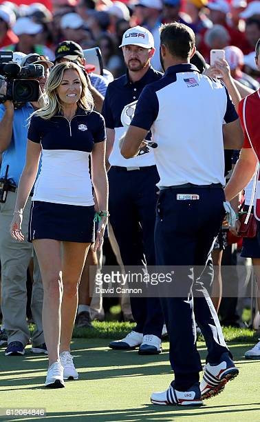 Dustin Johnson of the United States celebrates with Paulina Gretzky after winning his match during singles matches of the 2016 Ryder Cup at Hazeltine...