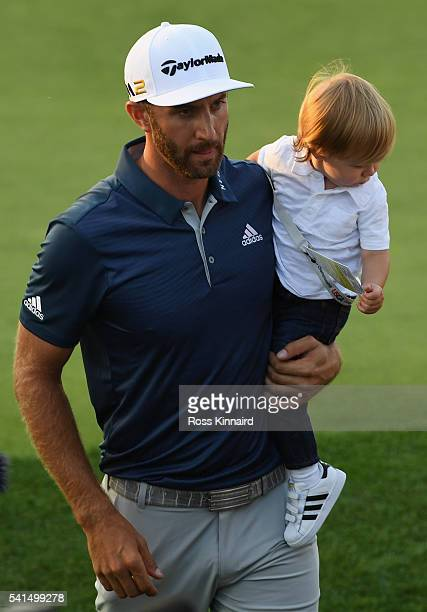 Dustin Johnson of the United States celebrates with son Tatum after winning the final round of the US Open at Oakmont Country Club on June 19 2016 in...