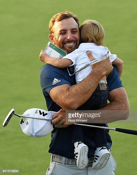 Dustin Johnson of the United States celebrates with son Tatum after winning the US Open at Oakmont Country Club on June 19 2016 in Oakmont...