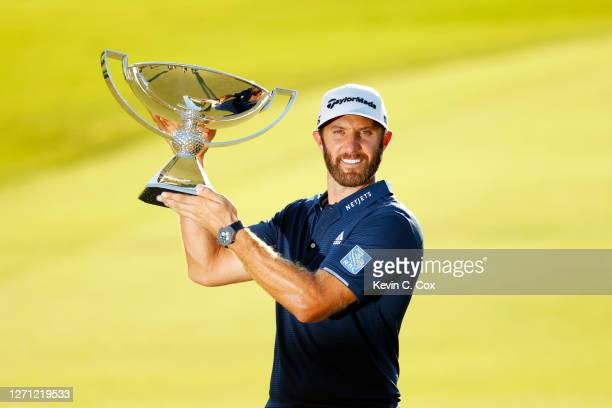 Dustin Johnson of the United States celebrates with the FedEx Cup Trophy after winning in the final round of the TOUR Championship at East Lake Golf...