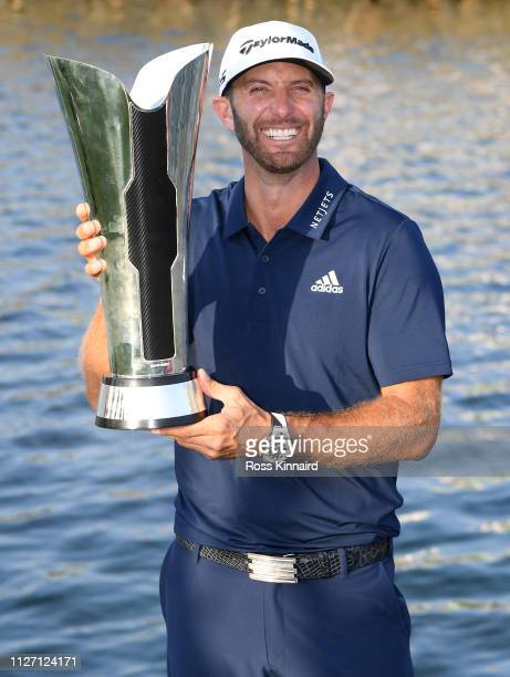 Dustin Johnson of The United States celebrates with the trophy after the final round of the Saudi International at the Royal Greens Golf & Country...