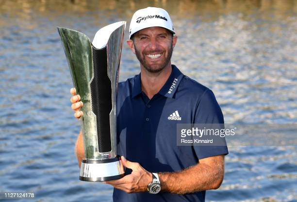 Dustin Johnson of The United States celebrates with the trophy after the final round of the Saudi International at the Royal Greens Golf Country Club...