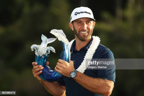 Dustin Johnson of the United States celebrates with the winner's trophy after winning during the final round of the Sentry Tournament of Champions at...