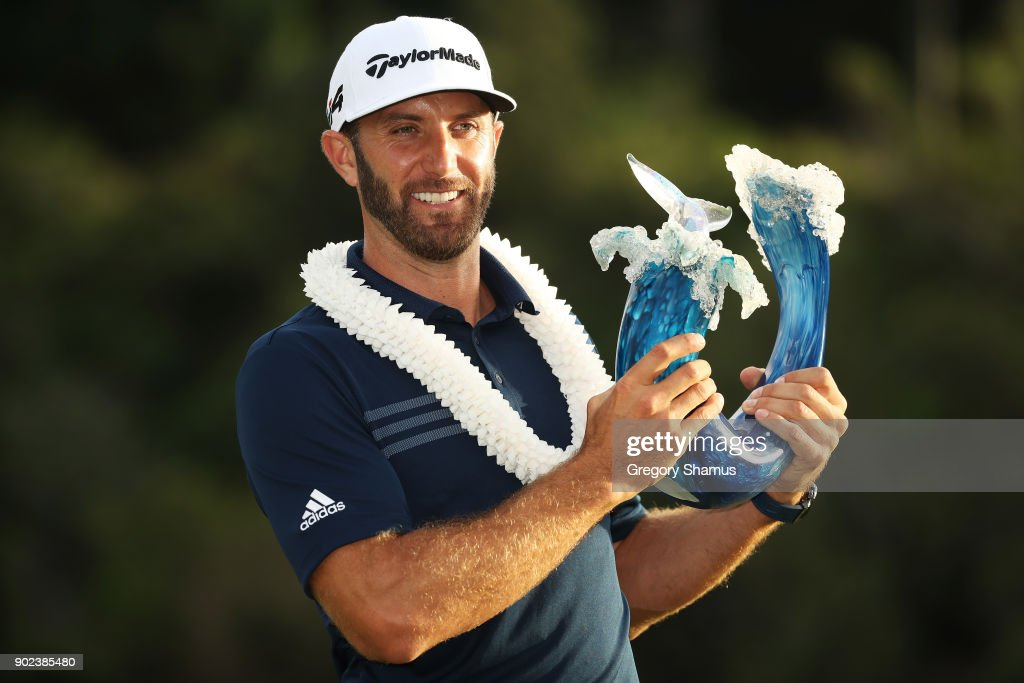 Dustin Johnson of the United States celebrates with the winner's trophy after winning during the final round of the Sentry Tournament of Champions at Plantation Course at Kapalua Golf Club on January 7, 2018 in Lahaina, Hawaii.