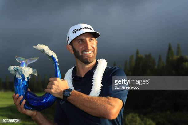 Dustin Johnson of the United States celebrates with the winner's trophy after the final round of the Sentry Tournament of Champions at Plantation...