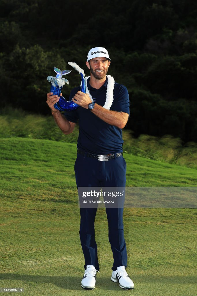 Dustin Johnson of the United States celebrates with the winner's trophy after the final round of the Sentry Tournament of Champions at Plantation Course at Kapalua Golf Club on January 7, 2018 in Lahaina, Hawaii.