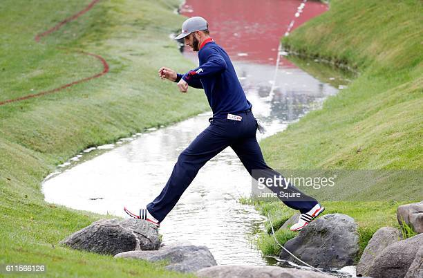 Dustin Johnson of the United States clears a water hazard on the seventh hole during morning foursome matches of the 2016 Ryder Cup at Hazeltine...