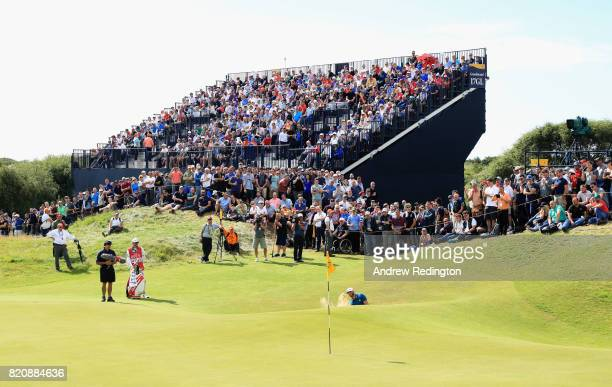 Dustin Johnson of the United States hits a bunker shot on the 17th hole during the third round of the 146th Open Championship at Royal Birkdale on...