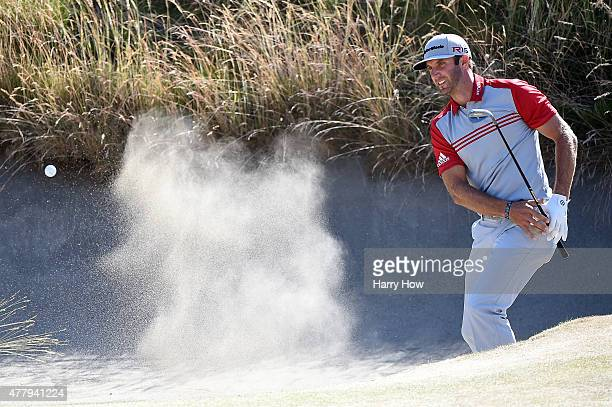 Dustin Johnson of the United States hits a bunker shot on the tenth hole during the third round of the 115th US Open Championship at Chambers Bay on...