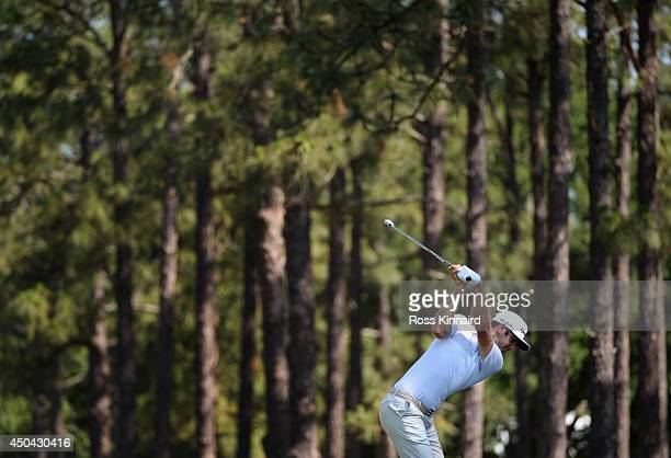 Dustin Johnson of the United States hits a shot during a practice round prior to the start of the 114th US Open at Pinehurst Resort Country Club...