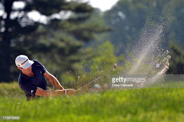 Dustin Johnson of the United States hits a shot from a bunker during a practice round prior to the start of the 113th U.S. Open at Merion Golf Club...