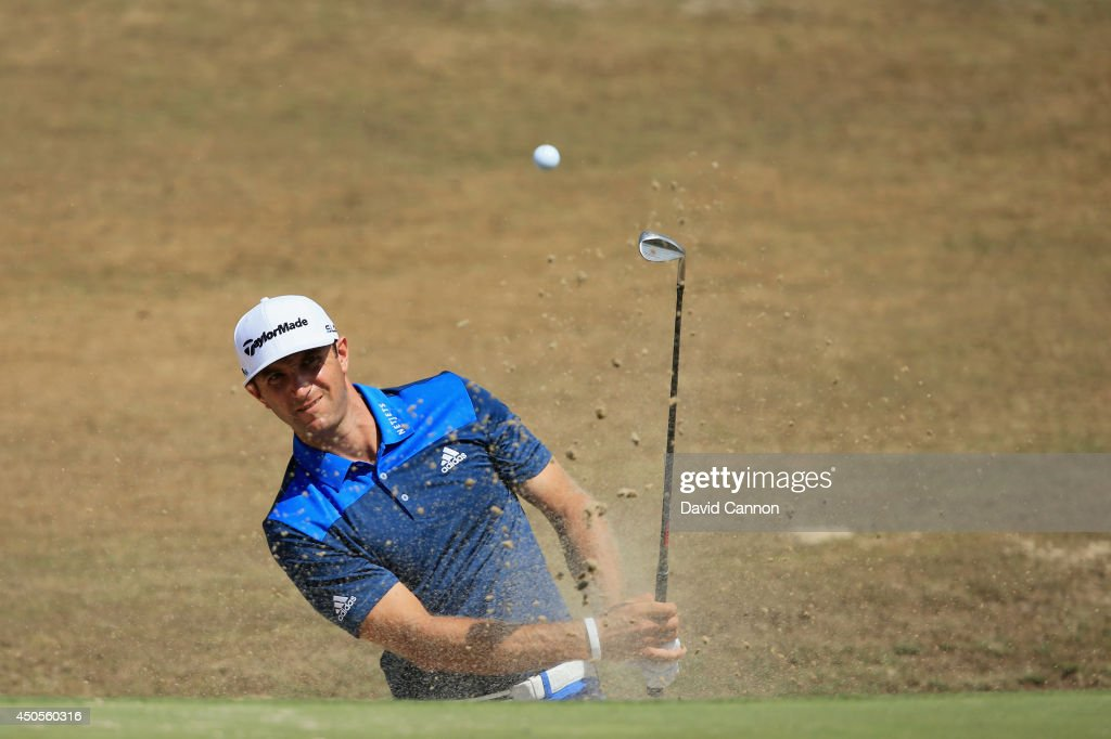 Dustin Johnson of the United States hits a shot from a greenside bunker on the fourth hole during the second round of the 114th U.S. Open at Pinehurst Resort & Country Club, Course No. 2 on June 13, 2014 in Pinehurst, North Carolina.