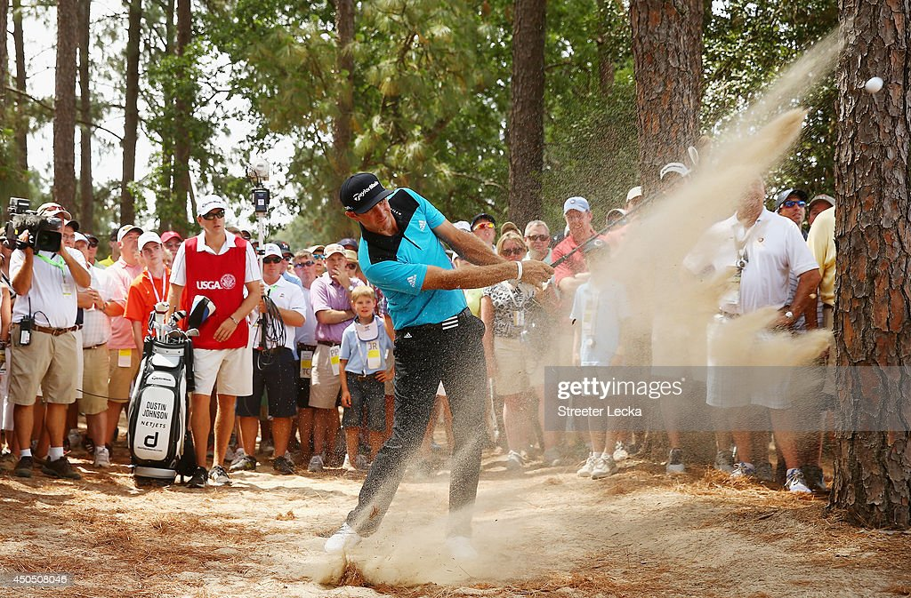 Dustin Johnson of the United States hits a shot from the natural habitat on the eighth hole during the first round of the 114th U.S. Open at Pinehurst Resort & Country Club, Course No. 2 on June 12, 2014 in Pinehurst, North Carolina.