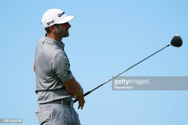 Dustin Johnson of the United States hits a tee shot on the 10th hole during the final round of the Sentry Tournament of Champions at the Plantation...