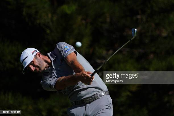 Dustin Johnson of the United States hits a tee shot on the 2nd hole during the final round of the Sentry Tournament of Champions at the Plantation...