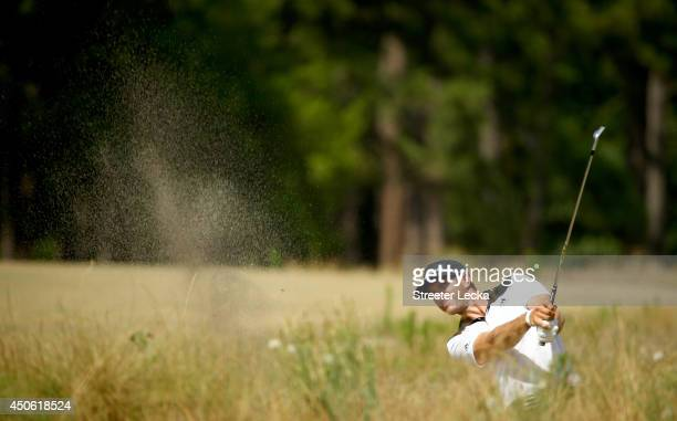 Dustin Johnson of the United States hits an approach shot on the fifth hole during the third round of the 114th U.S. Open at Pinehurst Resort &...