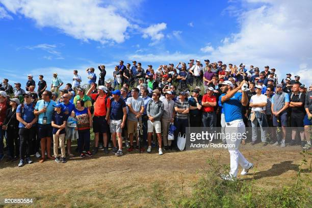 Dustin Johnson of the United States hits his second shot from the rough on the 16th hole during the third round of the 146th Open Championship at...