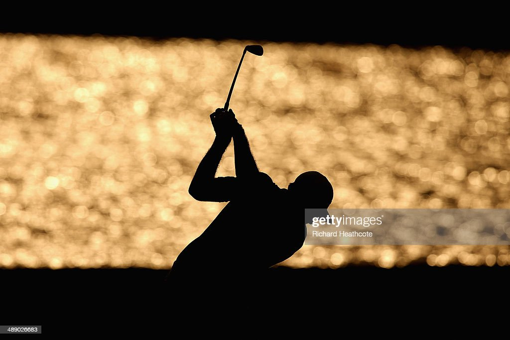 Dustin Johnson of the United States hits his second shot on the 18th hole during the second round of THE PLAYERS Championship on The Stadium Course at TPC Sawgrass on May 9, 2014 in Ponte Vedra Beach, Florida.