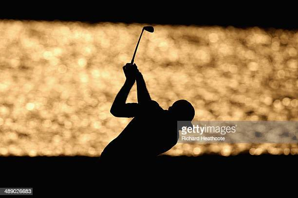 Dustin Johnson of the United States hits his second shot on the 18th hole during the second round of THE PLAYERS Championship on The Stadium Course...