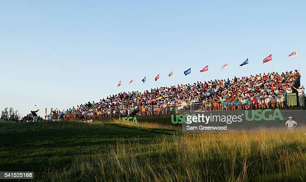 Dustin Johnson of the United States hits his tee shot on the 18th hole during the final round of the US Open at Oakmont Country Club on June 19 2016...