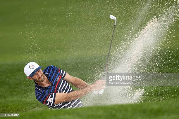 Dustin Johnson of the United States hits out of a bunker during practice prior to the 2016 Ryder Cup at Hazeltine National Golf Club on September 29,...