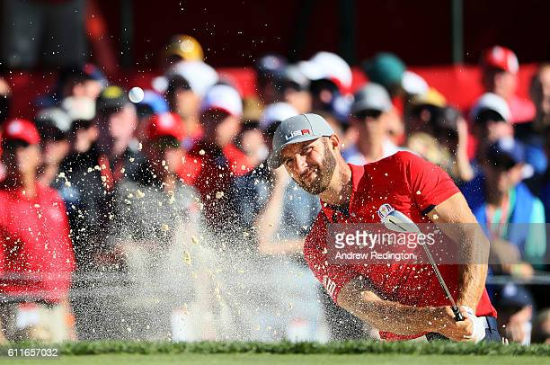Dustin Johnson of the United States hits out of a bunker on the sixth hole during afternoon fourball matches of the 2016 Ryder Cup at Hazeltine...