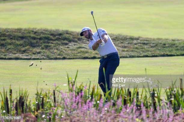 Dustin Johnson of the United States hits to the 18th green during the second round of The Northern Trust at TPC Boston on August 21, 2020 in Norton,...