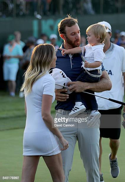 Dustin Johnson of the United States holds his son Tatum as his partner Paulina Gretzky looks on during the final round of the 2016 USOpen at Oakmont...