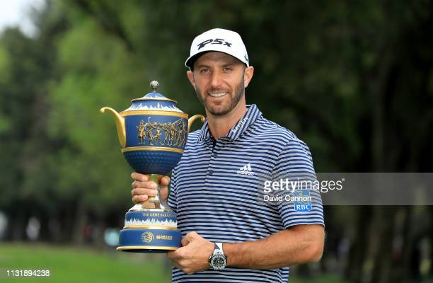 Dustin Johnson of the United States holds the Gene Sarazen Trophy after his five shot victory during the final round of the World Golf...