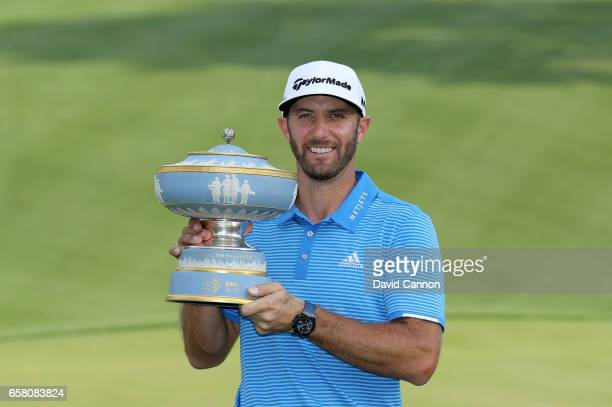 Dustin Johnson of the United States holds the Walter Hagen Trophy after his 1 up win in his match against John Rahm of Spain during the final of the...