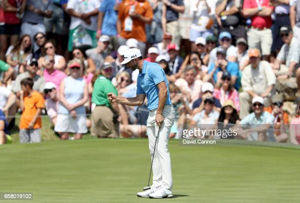 Dustin Johnson of the United States holes a par putt on the opar 4, 18th hole to win his match against Hideto Tanihara of Japan during the semi-final...