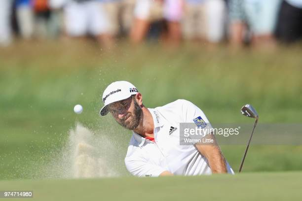 Dustin Johnson of the United States holes out for a birdie on the eighth hole during the first round of the 2018 US Open at Shinnecock Hills Golf...