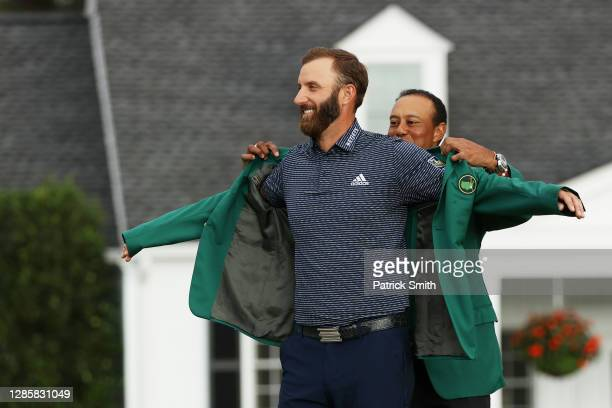 Dustin Johnson of the United States is awarded the Green Jacket by Masters champion Tiger Woods of the United States during the Green Jacket Ceremony...